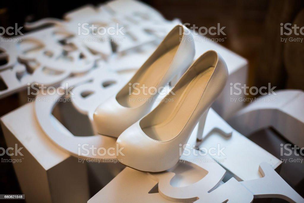 white bridal shoes,bride fees bride morning, ladies shoes, wedding fashion wedding, stylish shoes stock photo