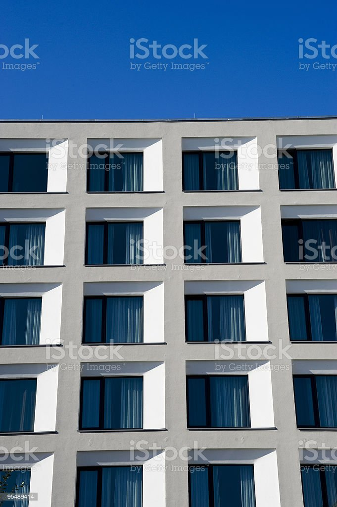 White building against a blue sky royalty-free stock photo