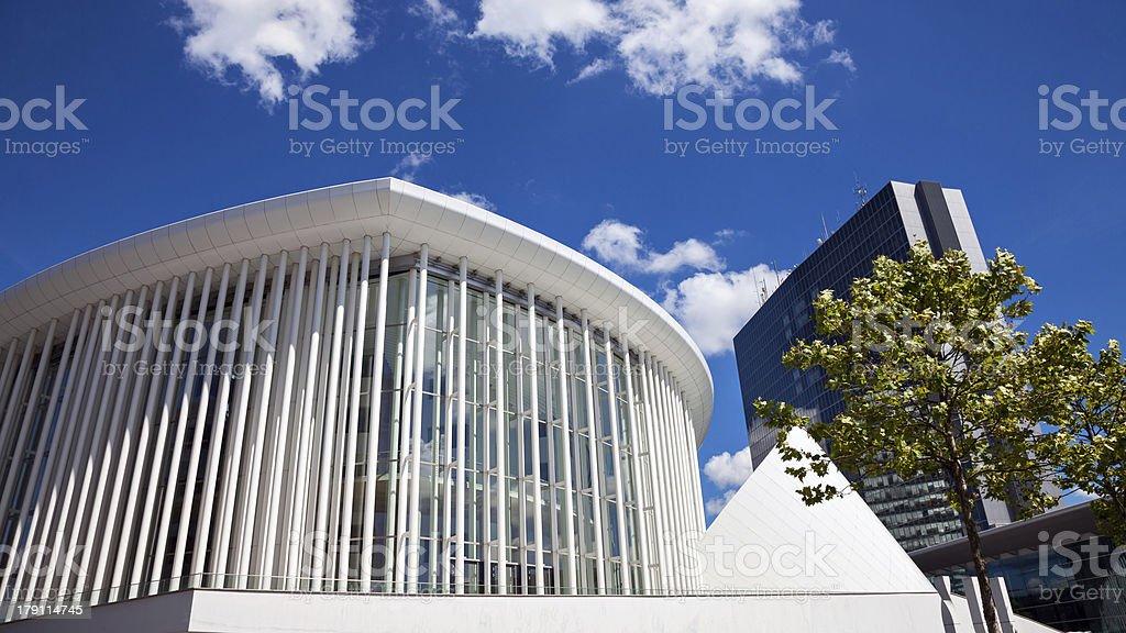 A white building nestled amongst a blue sky stock photo