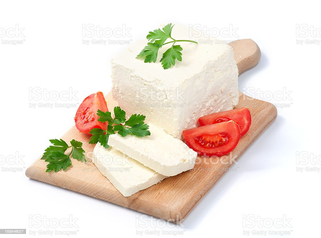 White Bulgarian cheese, arranged with tomatoes and parsley stock photo