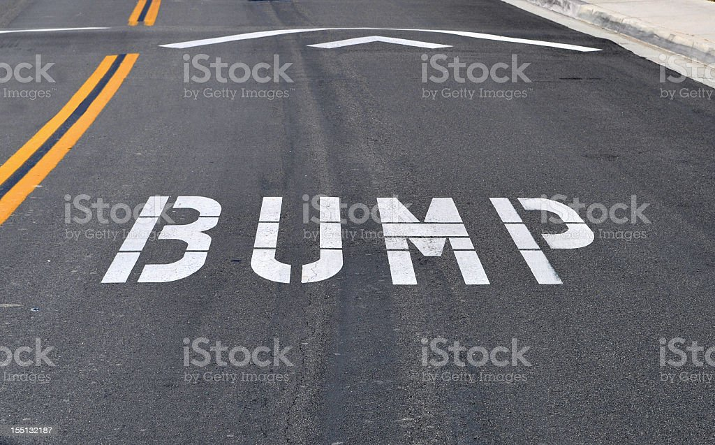 White bump road marking on black tarmac stock photo