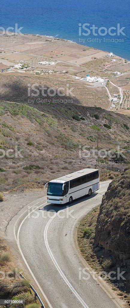 White bus driving near Oia Santorini, Greece stock photo