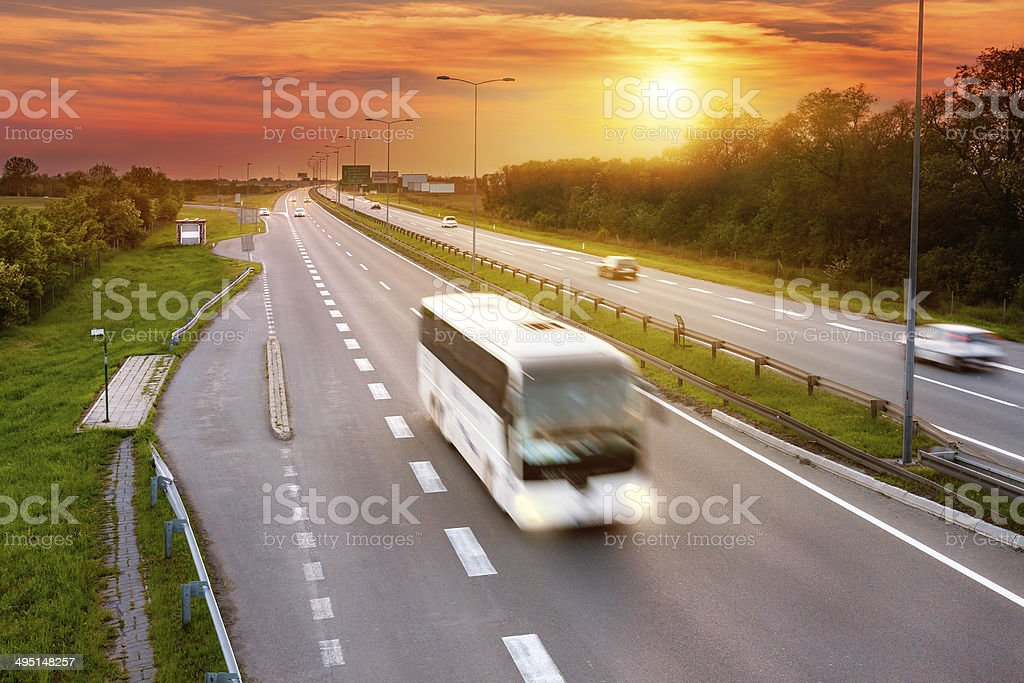 White bus in the rush hour on highway stock photo