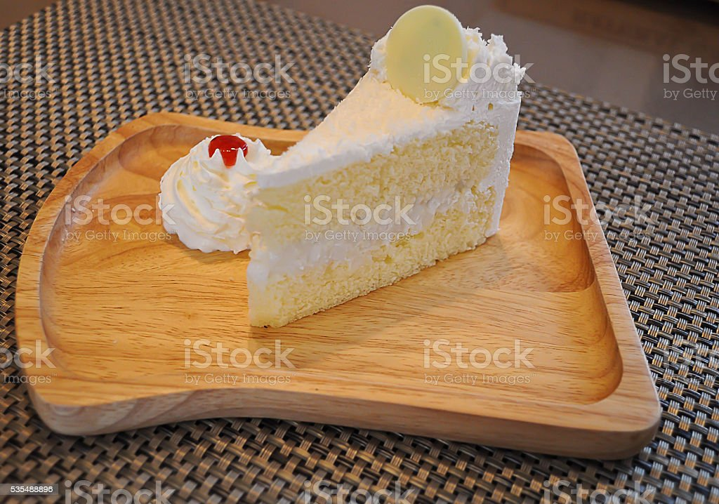 White cake on wood dish the delicious. stock photo