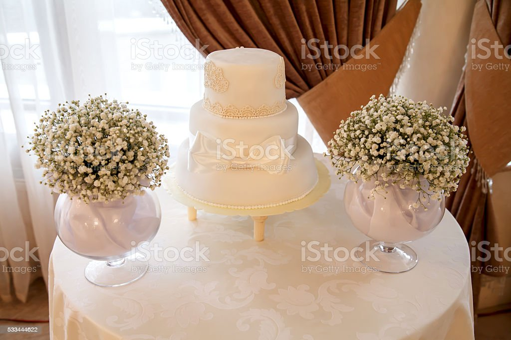 White cake with bow stock photo