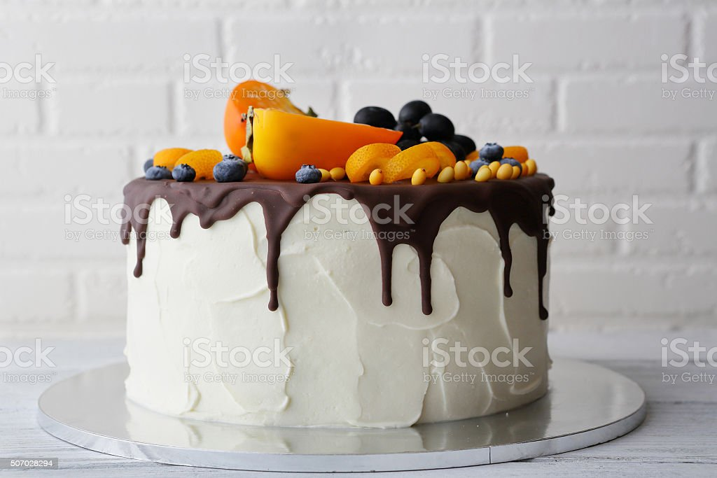 white cake with chocolate icing stock photo
