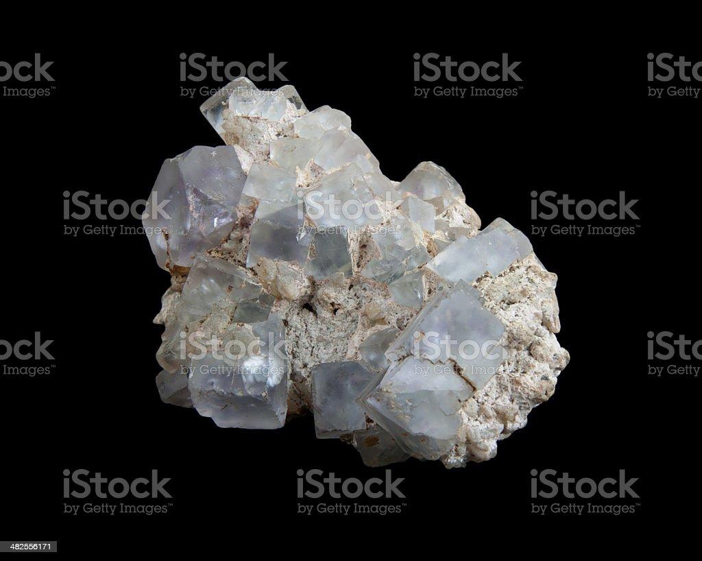 White calcite crystals on purple fluorite stock photo