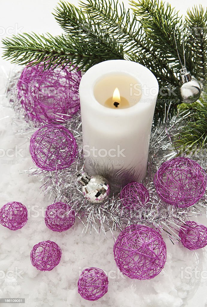 White candle and Christmas decorations around royalty-free stock photo