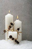 White candle with christmas decor