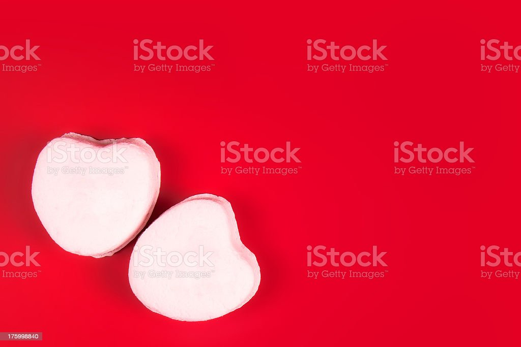 White Candy Hearts on Red stock photo