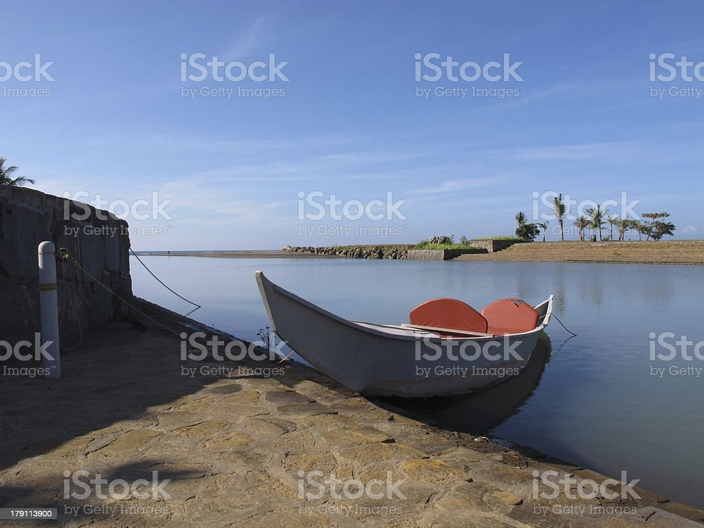 White Canoe with red seats royalty-free stock photo