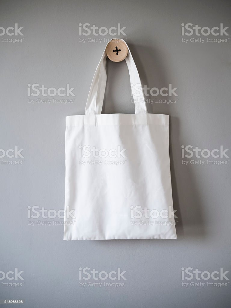 White Canvas Bag on Grey Background stock photo