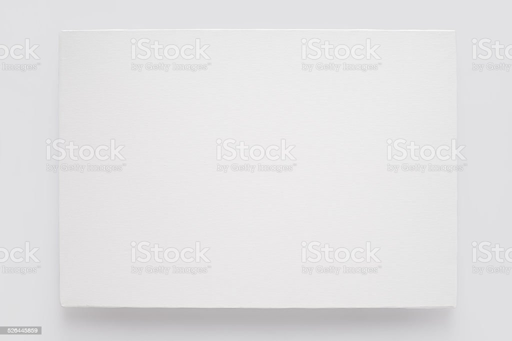 White canvas on stretcher on white wall stock photo