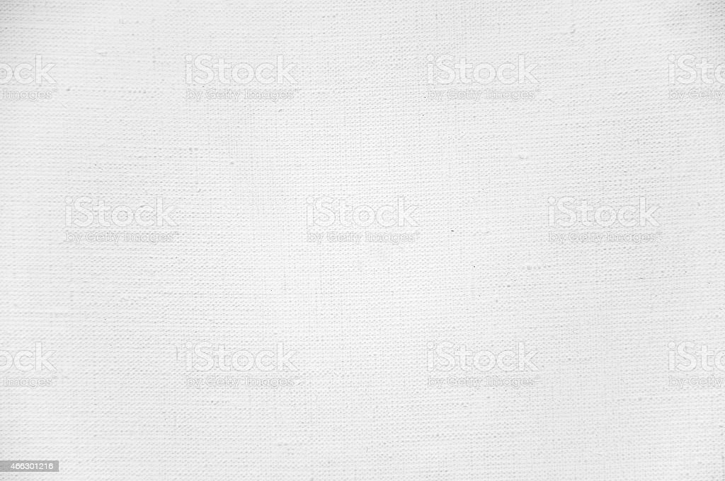 A white canvas textured background stock photo