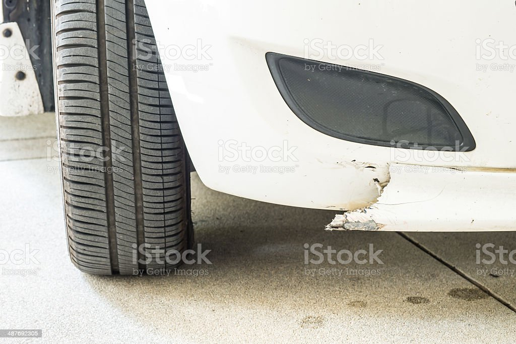 White Car accident with broken on the front bumper(skirt), insur stock photo