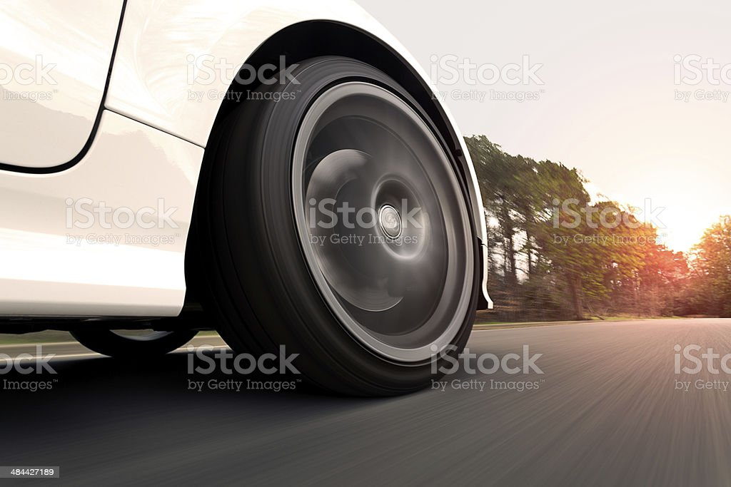 White Car Driving into the Sunset stock photo