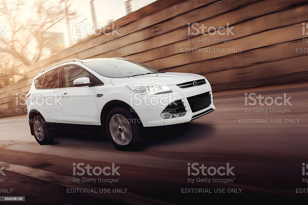White car Ford Kuga fast drive on road stock photo