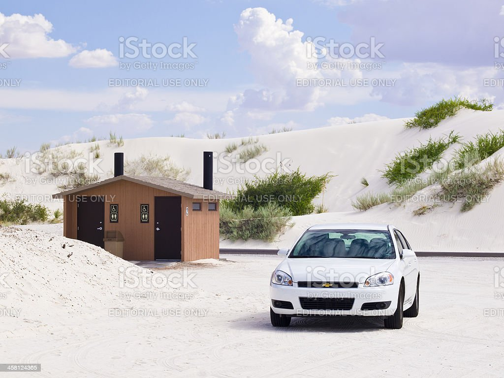 white car in  dunes stock photo
