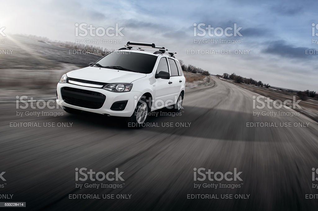 White car Lada Kalina drive speed on winter road stock photo