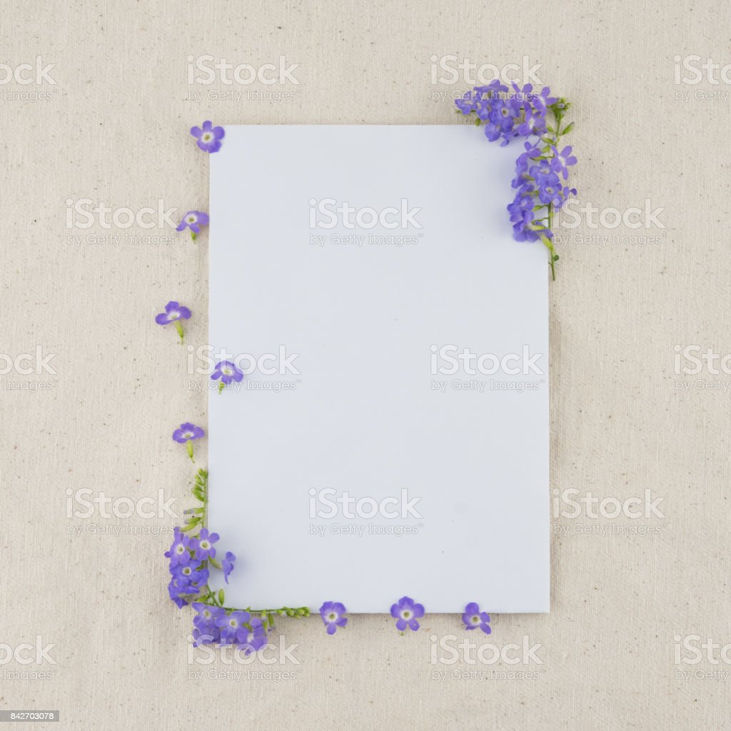 White card decorated with purple flower stock photo