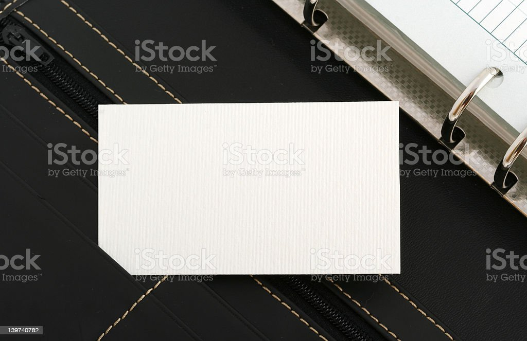 white card on notebook royalty-free stock photo