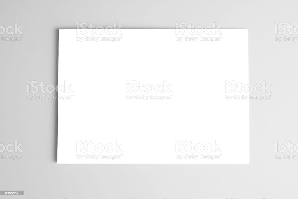 White card over gray background stock photo