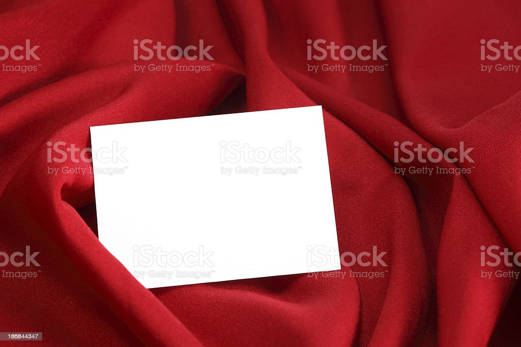 white card with space for text on red satin stock photo