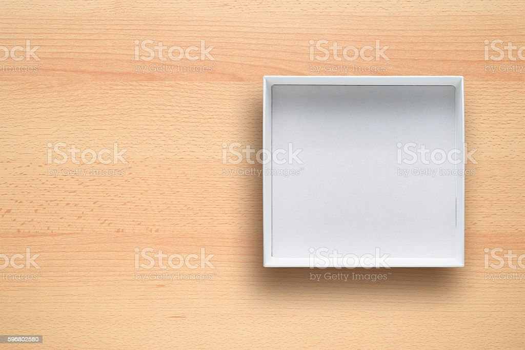 White cardboard box on desk top view stock photo