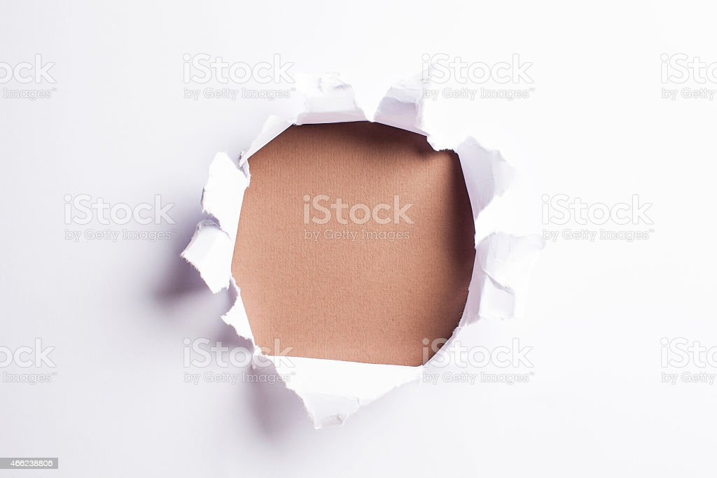 White card/paper with torn hole in the middle, colourful background stock photo