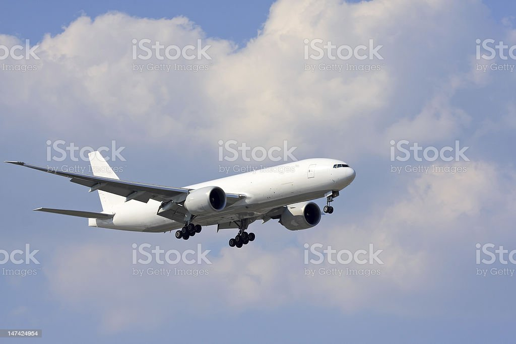 White cargo aircraft on approach stock photo