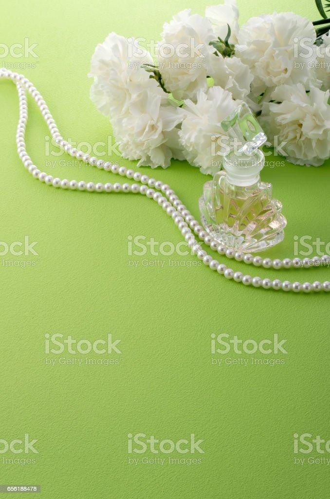 white carnation and perfume bottle stock photo