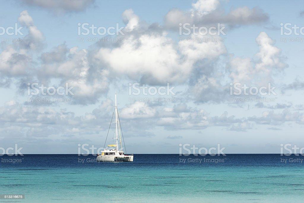 White Catamaran in Incredible Blue Sea in Rangiroa, French Polynesia stock photo