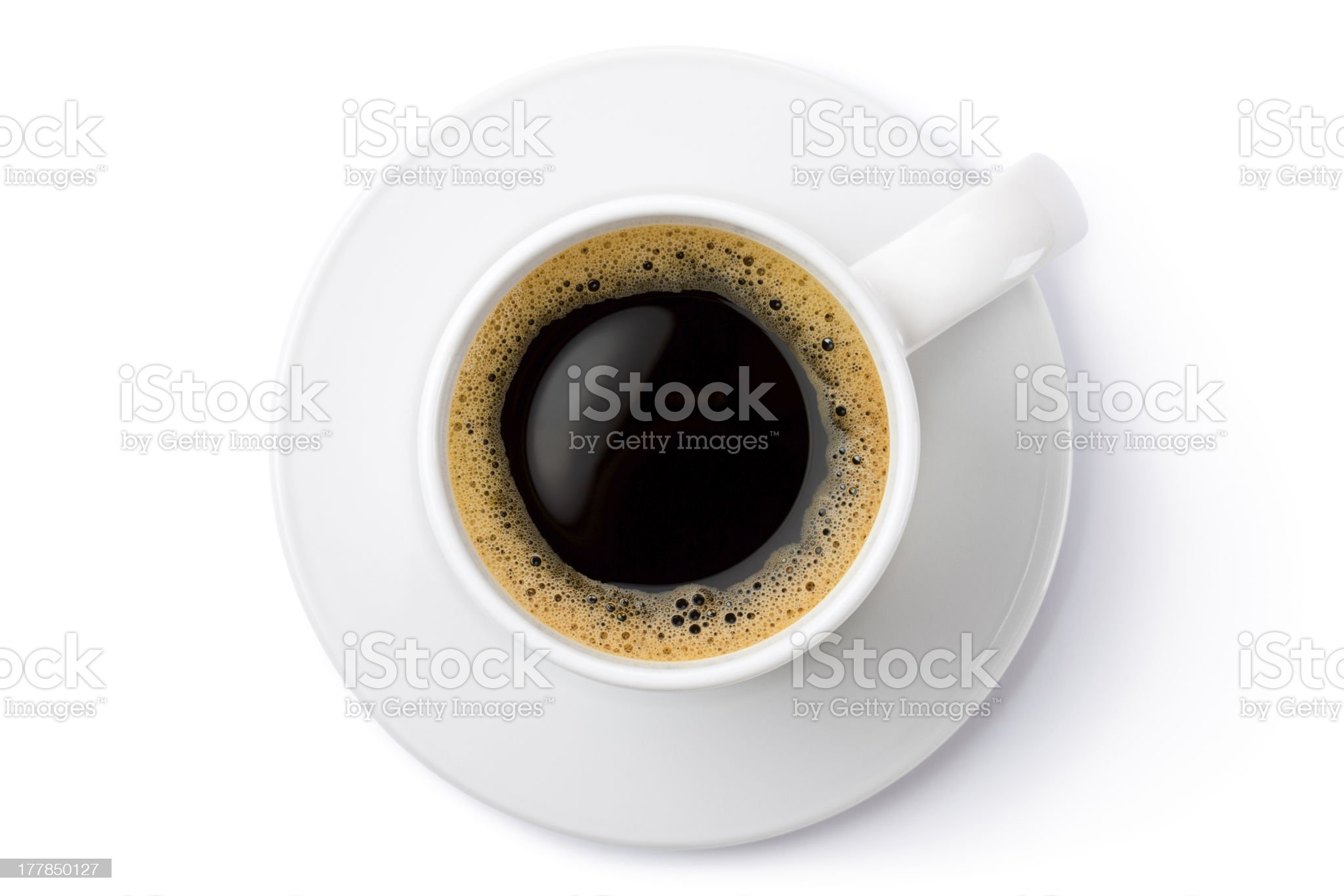White ceramic coffee mug on the saucer. Top view. royalty-free stock photo