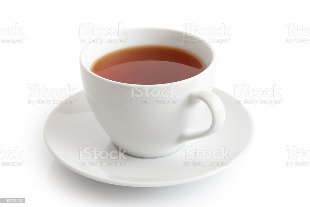 White ceramic cup and saucer with rooibos tea. stock photo
