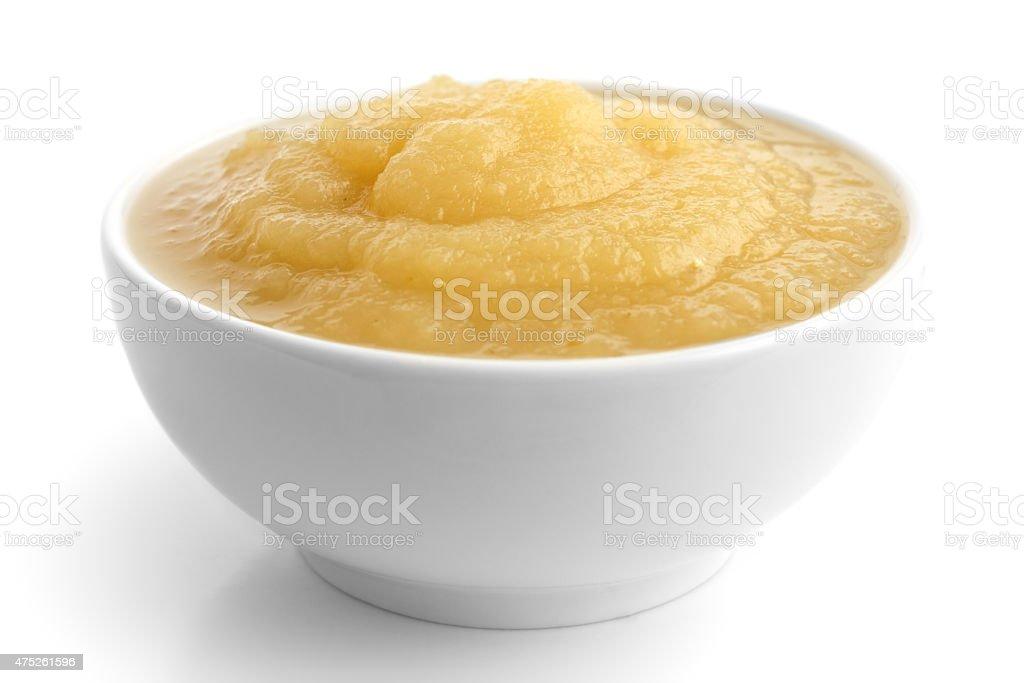White ceramic dish of apple sauce on white. stock photo