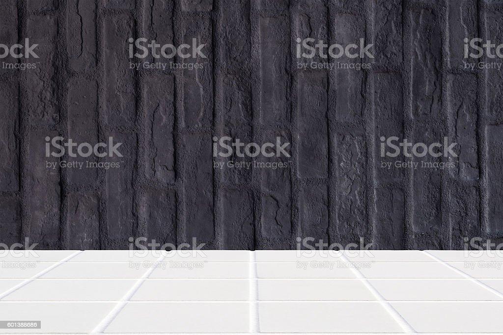white ceramic mosaic floor and black brick wall stock photo