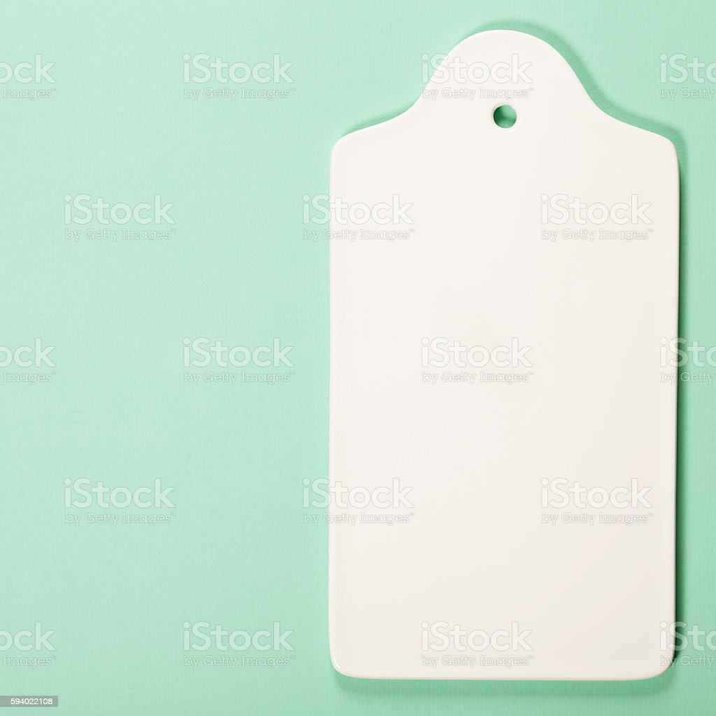 White ceramic serving board over light blue background stock photo