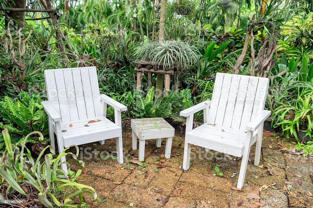 White chair and table relaxation in garden stock photo