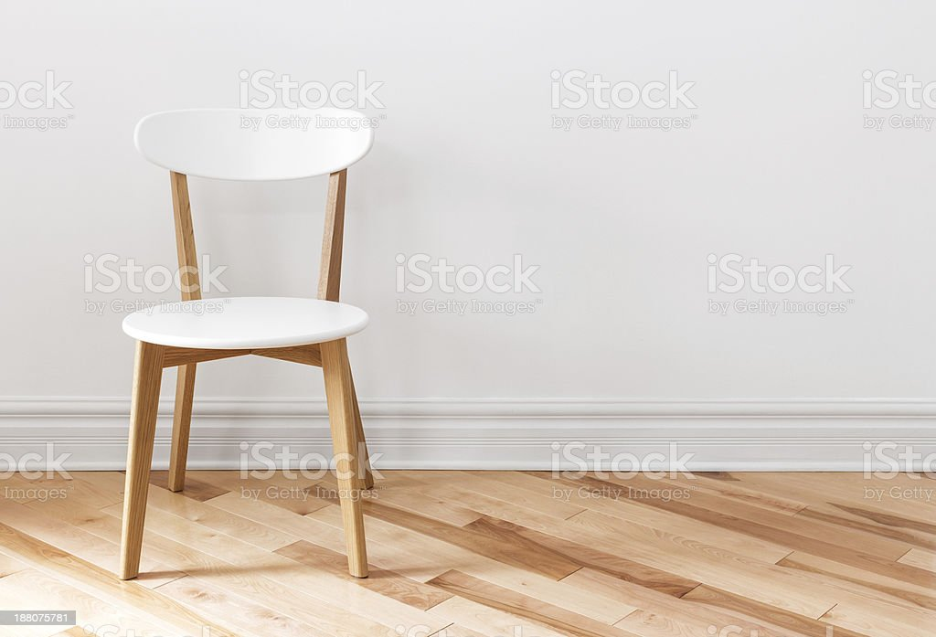 White chair in an empty room stock photo