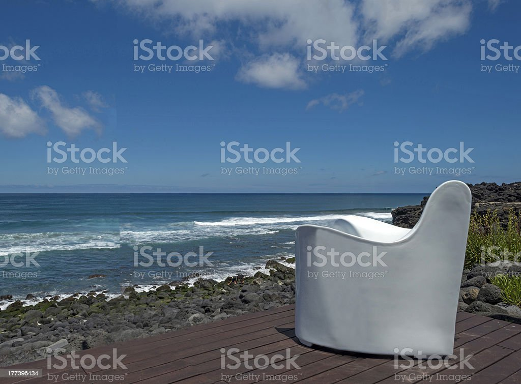 White chair on a terrace along the Atlantic Ocean royalty-free stock photo