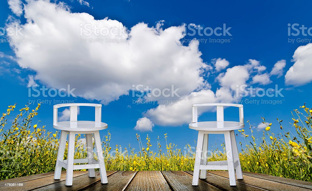 white chairs and blue sky stock photo