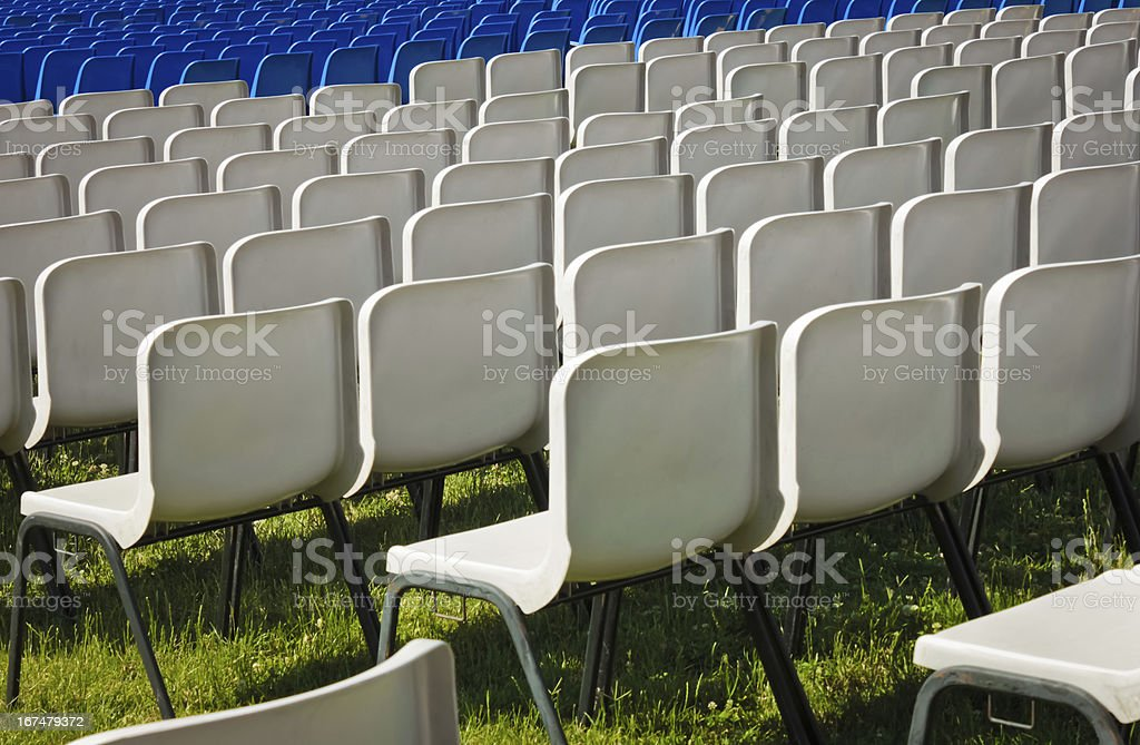 white chairs before a concert stock photo