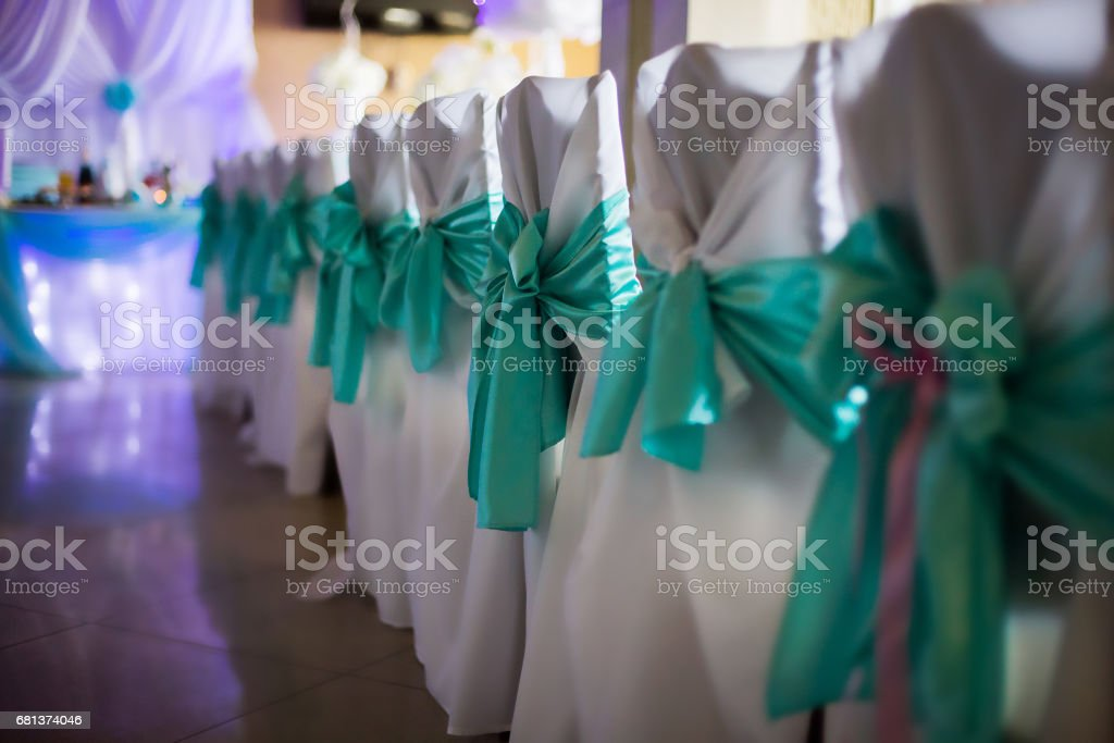 white chairs decorated for wedding, wedding ceremony, restaurant, wedding table and chairs, a feast stock photo