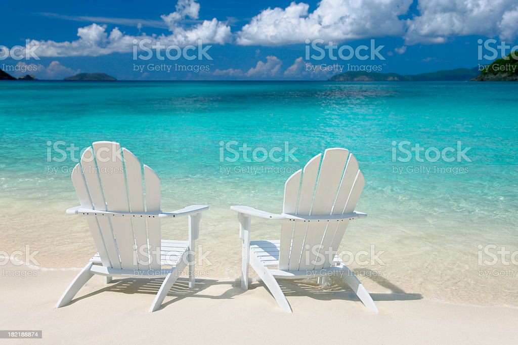 white chairs on the Caribbean beach stock photo