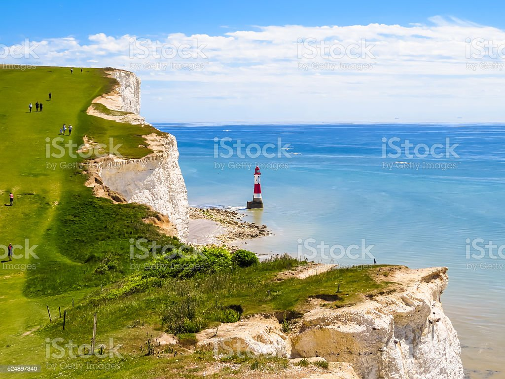 White chalk cliffs and Beachy Head Lighthouse stock photo