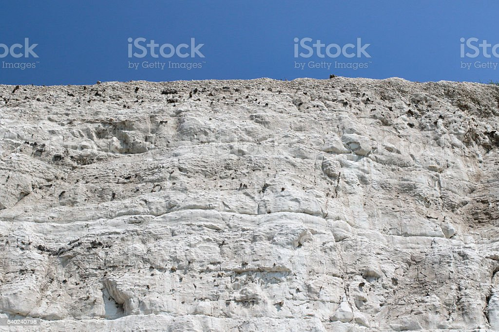 White chalk cliffs blue sky background copy space stock photo