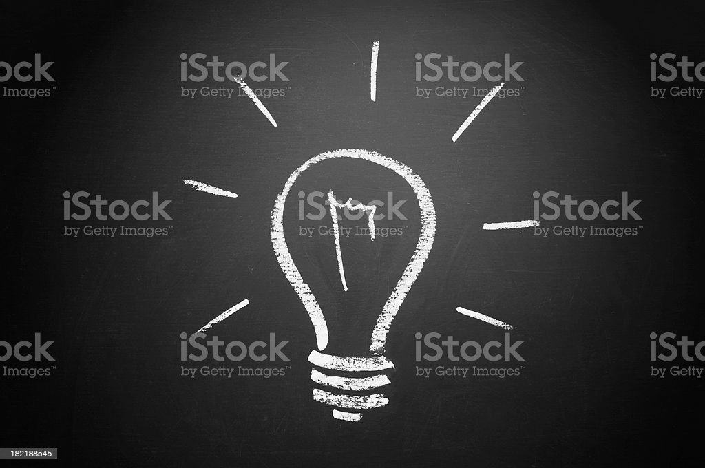 White chalk draw of bulb on blackboard royalty-free stock photo