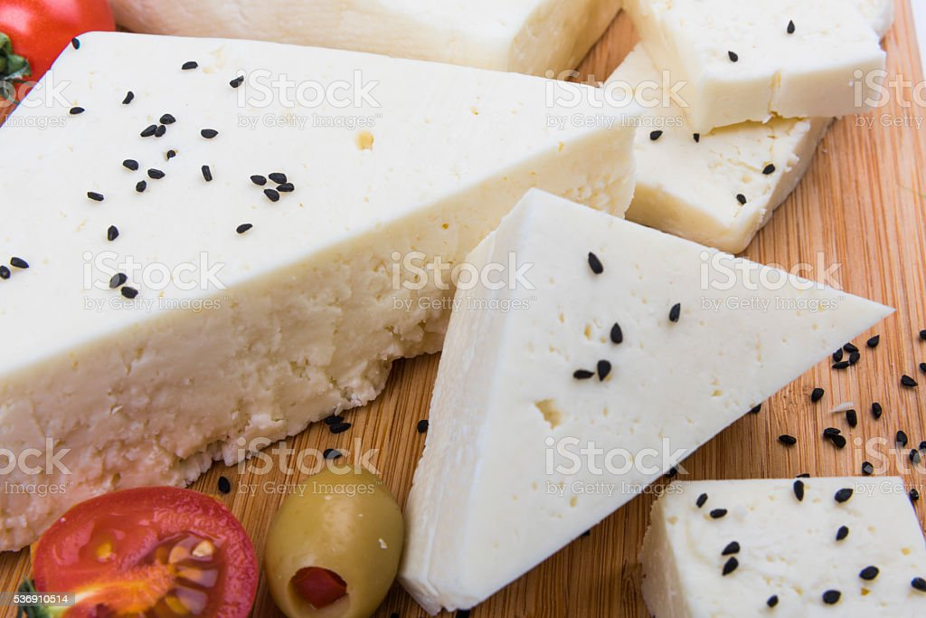 White cheese with tomatoes stock photo