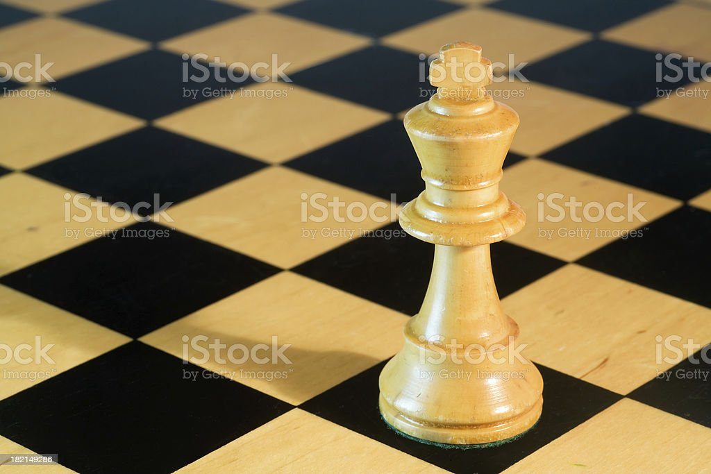 White Chess King on Chessboard royalty-free stock photo