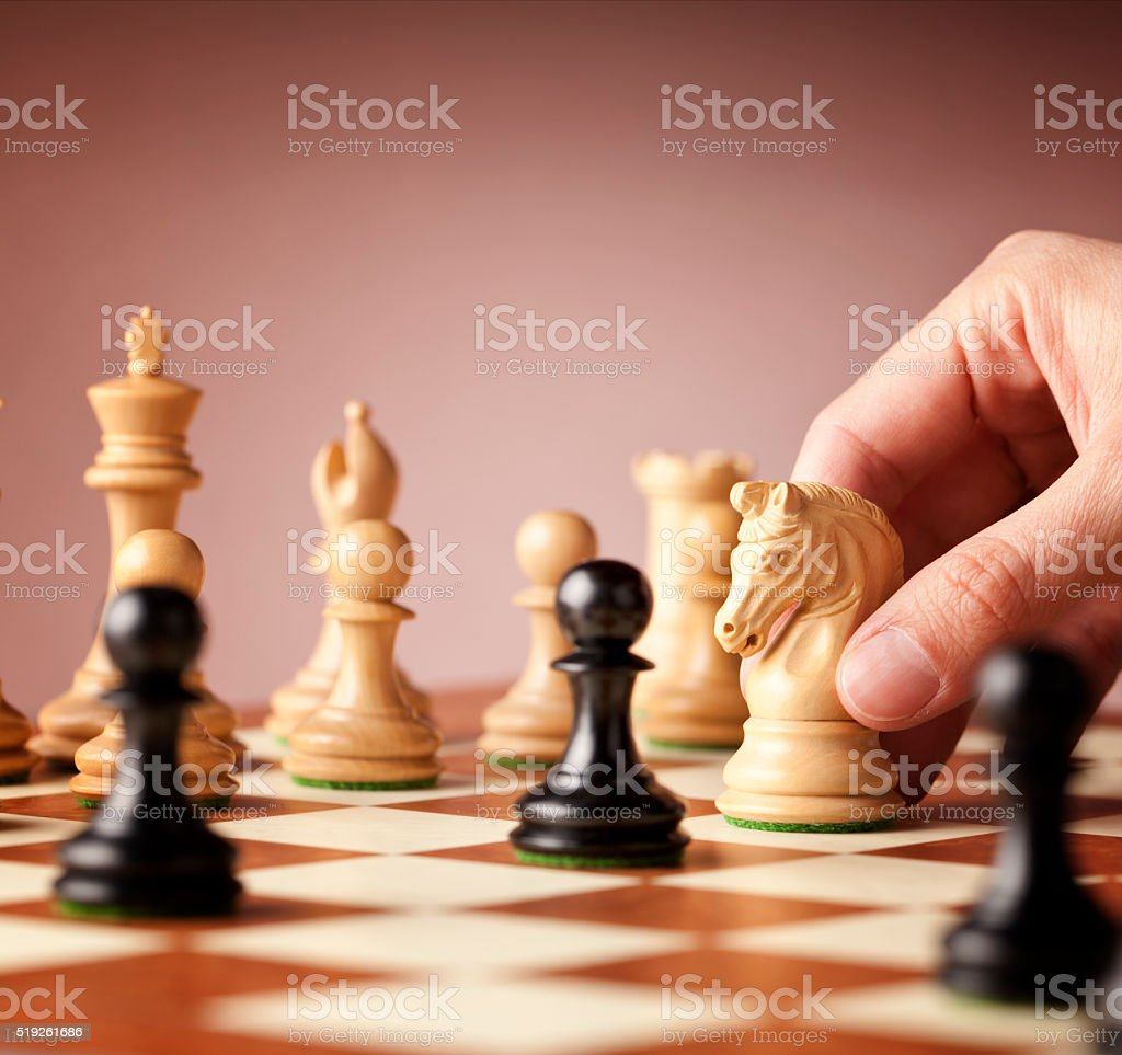 White chess knight in action stock photo